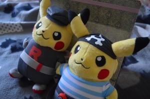 Team Rocket and Pirate dressed Pikachu plushies.