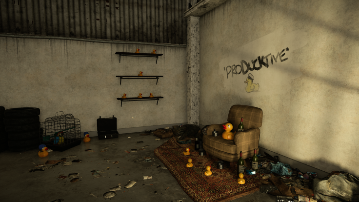 """Ducks all looking up at a larger rubber duck in a brown chair by a wall with """"producktive"""" written in the wall"""