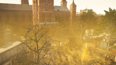 A yellow tinged image of the Castle Settlement which is a grand building and some trees and garden area