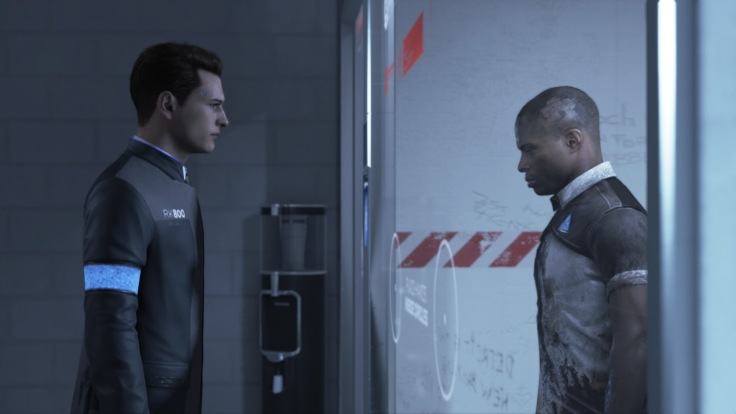 Two characters, both androids, are separated by a glass wall. One assisting with police investigations and one kept in custody.