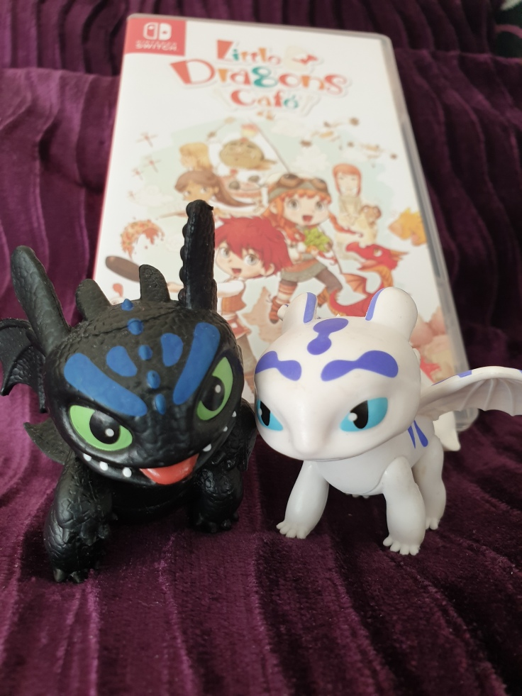 Toothless and Lightfury guard the Little Dragons Cafe game