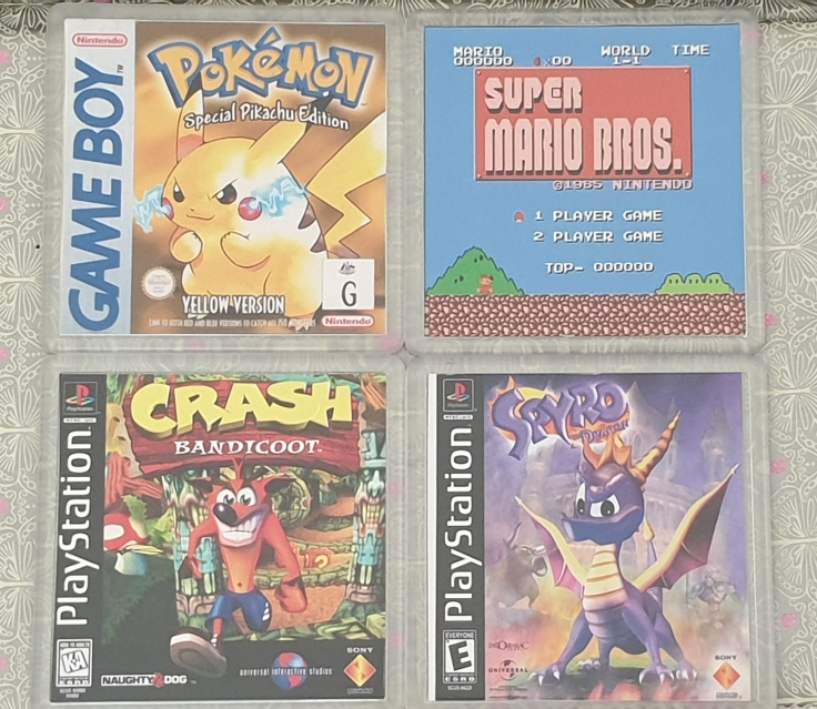 A Game Boy Pokémon Yellow, Playstation Crash Bandicoot, Playstation Spyro the Dragon and Super Mario Bros coasters.