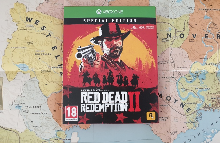Special Edition cover of Red Dead Redemption 2 sitting on top of the opened out map for the game.
