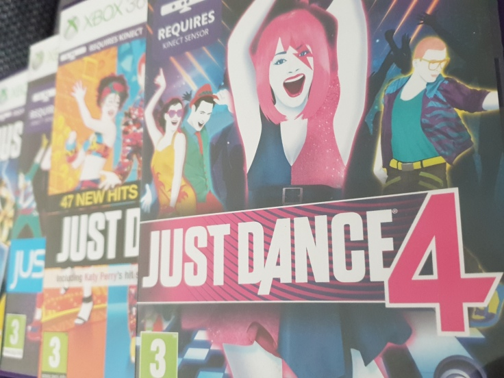 A selection of Just Dance game boxes partially sitting on each other.