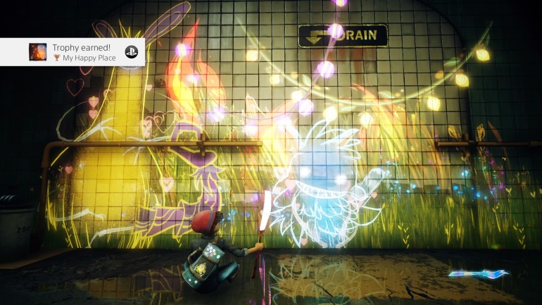 "A Concrete Genie screenshot from PS4.  It shows Ash with their paintbrush and a genie on the wall with some painted designs around it.  The trophy is called ""My happy place""."